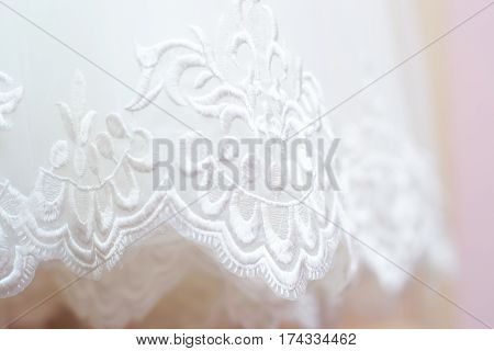 Beautiful white background of the wedding dresses with embroidery and ornaments
