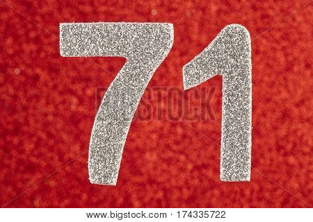 Number seventy-one silver color over a red background. Anniversary. Birthday