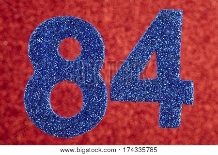 Number eighty-four blue color over a red background. Anniversary. Horizontal