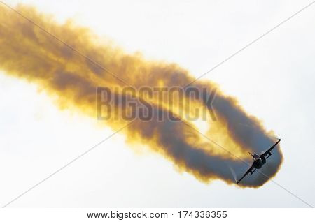 Fighter jet aircraft with smoke aerobatic maneuvers. Russia. Moscow 29 August 2015