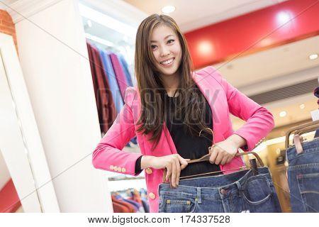 young beautiful chinese woman shopping in modern shopping mall