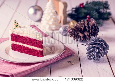 Christmas Cake On Plate On Red Fabric On Wood Background And Decorations