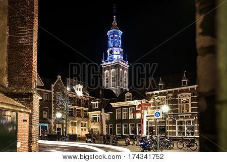 KAMPEN, NETHERLANDS - December 10, 2016: Long Exposure night photo of new tower in the medieval Hanseatic city from the butter market in Kampen, Overijssel - Netherlands.