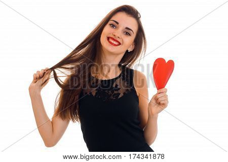 beautiful young girl in black dress holding a postcard sweetheart smiles and straightens hair isolated on white background