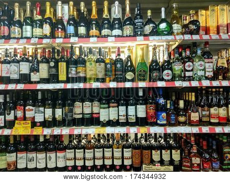 MOSCOW - MARCH 03, 2017: Showcase with bottles in liquor store
