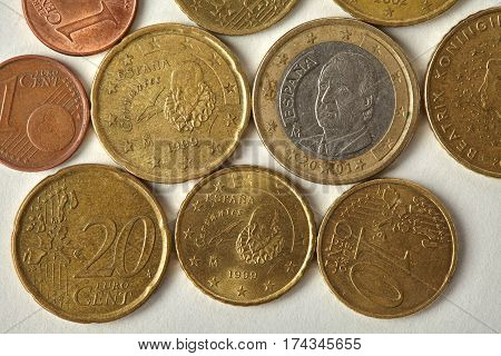 Espana Spain Euro cent coins macro view. Aged money currency closeup, textured engraving etching on paper background