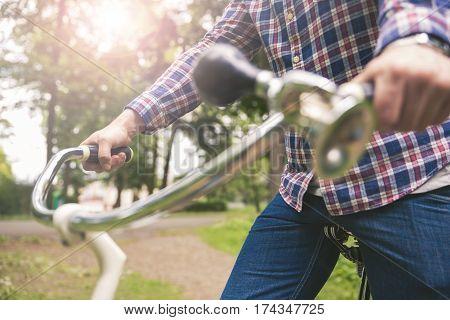 Man Hands Holding Bike Handlebar