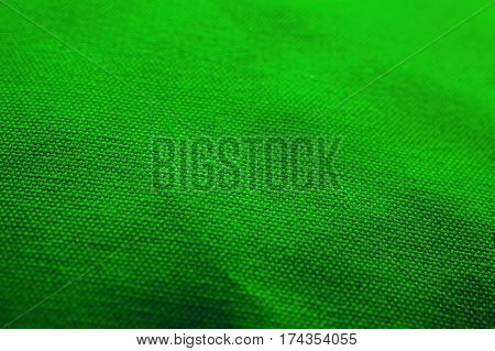 Green fabric texture. Green cloth background. Close up view of green fabric texture and background. Abstract background and texture for designers.