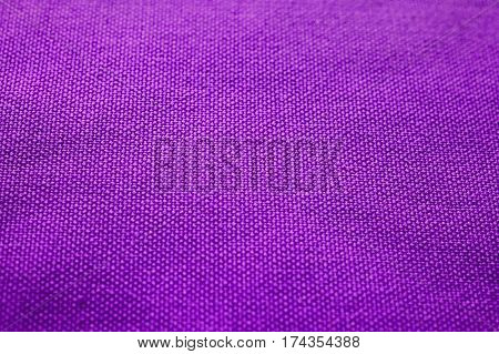 Purple fabric texture. Purple cloth background. Close up view of purple fabric texture and background. Abstract background and texture for designers. Purple texture. Purple background.