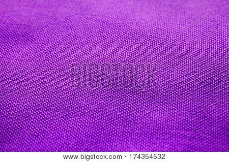 Purple fabric texture. Purple cloth background. Close up view of purple fabric texture and background. Abstract background and texture for designers. Purple texture. Purple background.