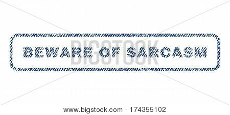 Beware Of Sarcasm text textile seal stamp watermark. Blue jeans fabric vectorized texture. Vector tag inside rounded rectangular banner. Rubber sign with fiber textile structure.