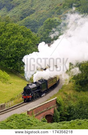 Steam Railway Engine in full steam running as The Yorkshire Coast Express