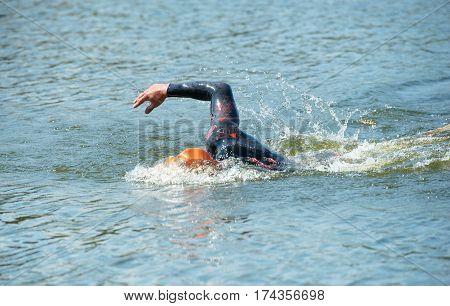 Triathlon Cup of Ukraine and Cup of Bila Tserkva. July 24 2016 in Bila Tserkva. Young man swimming in race.