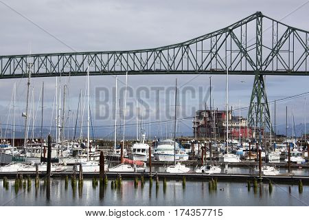 The view of Astoria town marina with Astoria-Megler Bridge over Columbia River (Oregon).