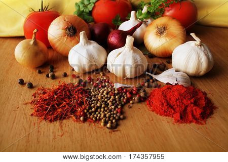 Herbs and spices assortment on wooden background