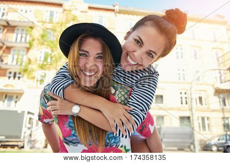 Teen On Shoulder Of Friend Laughing