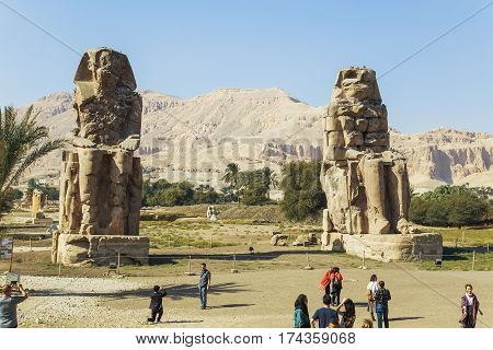 Ancient Colossi Of  Memnon And Tourists