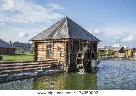Vintage wooden water mill in working order.