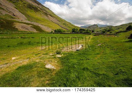 Looking East in the former copper mining Drws-y-coed Valley towards Clogwn y Gygarreg and Snowdon. Drwsycoed Snowdonia National Park Gwynedd Wales United Kingdom.