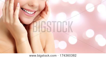 Smiling woman on an abstract background with blurred lights