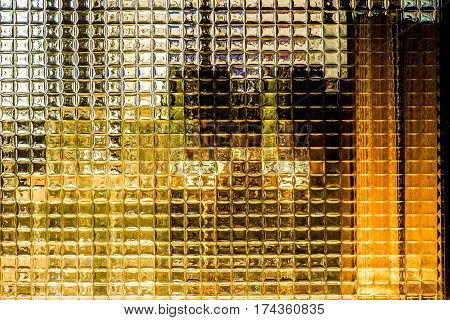 Glass block wall background crystal milky quartz pattern in restaurant behind is glass.