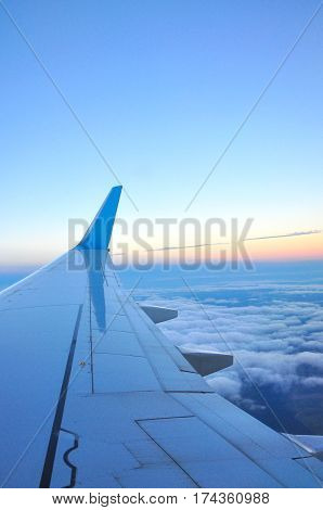 sunset clouds and sky as seen through window of an aircraft