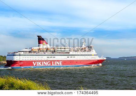 Helsinki Finland - August 4 2012: Cargo-passenger cruise ferry Viking Line - Gabriella goes from port Helsinki across Bay Kruunuvuorenselka near island Suomenlinna. Suomi Helsingfors South Gulf