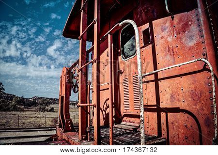 A train caboose sitting on the tracks in southern California.