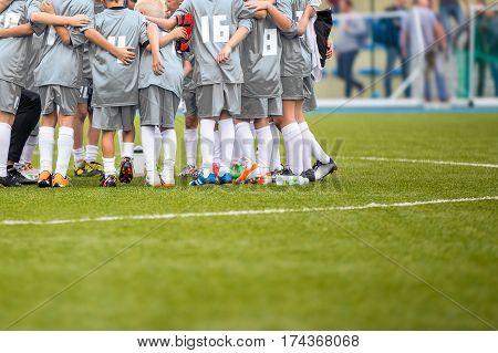 Coach giving young soccer team instructions. Youth soccer team together before final game. Football match for children. Boys group shout team gathering. Coach briefing. Soccer football background