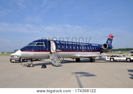 NEWPORT NEWS, VA, USA - MAY. 3, 2012: US Airways Express Bombardier CRJ (Canadair Regional Jet) 200 at Newport News Williamsburg International Airport (PHF) in Newport News, Virginia, USA.