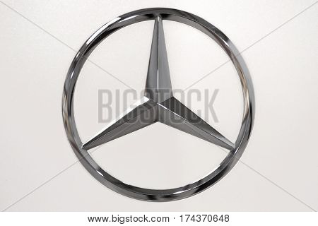 Krakow Poland - February 23 2017: Mercedes Benz Sign Close Up during Mobile-IT Exhibition. Mercedes is German luxury automobile manufacturer.