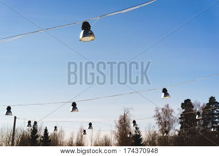 street lights hang. street lighting. Sunny day