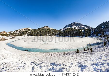 Crater Lake With Snow On Mount Lassen In The Lassen Volcanic National Park