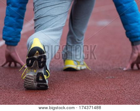 Closeup of man running shoes. male jogging at stadion.