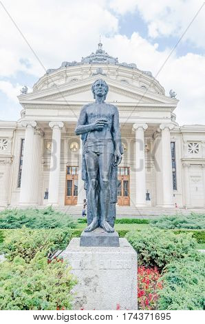 Bucharest, Romania - May 25, 2014: The Statue Of Mihai Eminescu In Front Of The Building Called