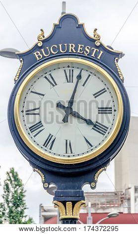 Bucharest, Romania - May 25, 2014: Outdoor City Clock Near University From Bucharest.