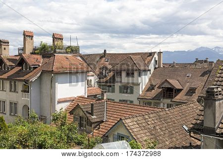 RAPPERSWIL SWITZERLAND - MAY 10 2016: Buildings and Their roofs form the landscape of the city these roofs are covered with ceramic tiles.