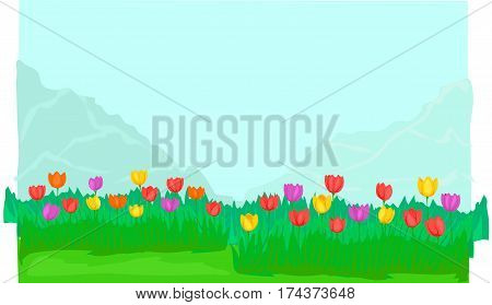 The green glade,lot of tulips in bloom, mountains.