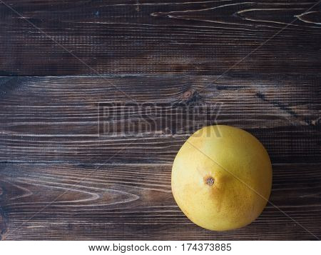 Fresh And Organic Pomelo Fruti On A Dark Wood Table