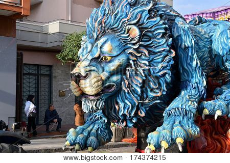 Acireale (CT) Italy - February 28 2017: detail of a allegorical float depicting a blue lion during the carnival parade along the streets of Acireale.