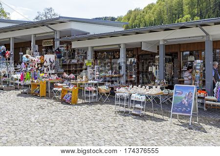 EINSIEDELN SWITZERLAND - MAY 09 2016: Stalls in which variety of souvenirs are put on sale. These stands due to its location offers religious souvenirs and much more