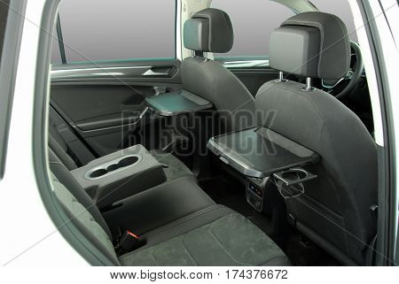 rear seat of the car with a raised plane tables