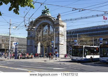 LUCERNE SWITZERLAND - MAY 05 2016: The old gate of an old railway station in front of the new one. Around this building there is a lot of traffic because of the many bus stops and the train station