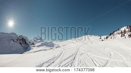 ski touring tracks in a winter panorama