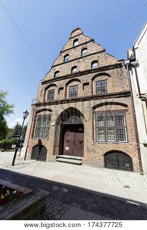 KOLOBRZEG POLAND - JUNE 23 2016: Townhouse of Merchants was built of brick early of the 15th century. This building was destroyed during the war then reconstructed in the years 1957-1963