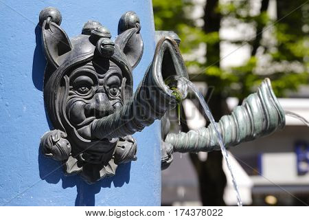 LUCERNE SWITZERLAND - MAY 06 2016: Fritschi Fountain detail that is a part of a pillar it is a type of tap from which body the water flows out.