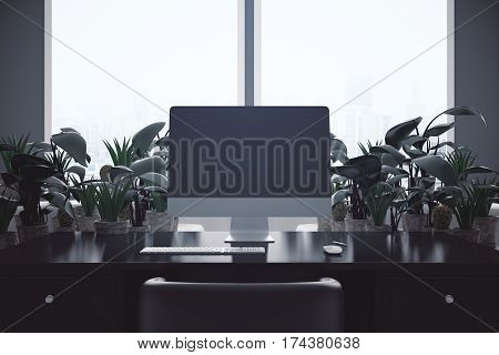 Backlit workplace with blank computer screen and decorative plants. Mock up 3D Rendering