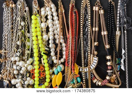 Colorful bijouterie and necklaces with beads hanging
