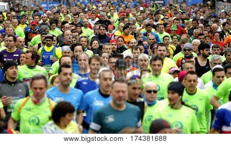 BARCELONA, SPAIN - FEB, 12: Street crowded with runners during Barcelona Half Marathon in Barcelona on February 12, 2017 in Barcelona Spain