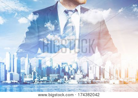 Thoughtful businessman in suit and tie on abstract city background with sunlight. Success concept